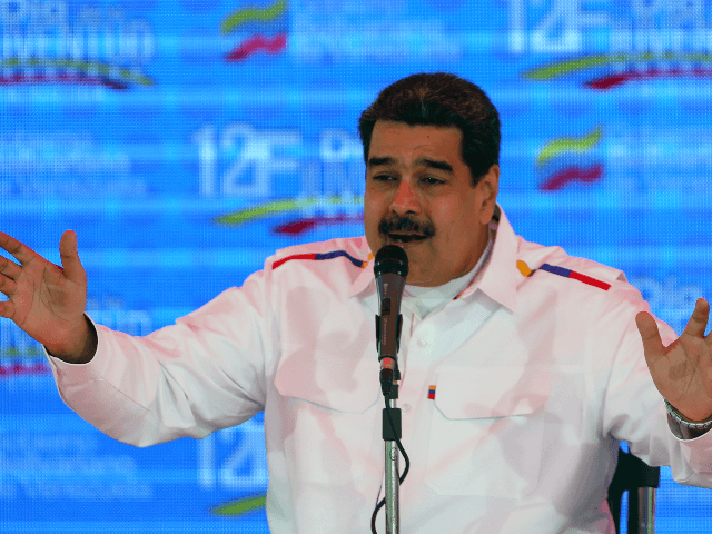 "Venezuela's President Nicolas Maduro gestures while delivering a speech in the framework of the ""Youth Day"" celebrations at the Bolivar Square in Caracas, Venezuela on February 12, 2019. - Venezuela's opposition leader Juan Guaido told tens of thousands of supporters on Tuesday that desperately-needed humanitarian aid would be brought into …"