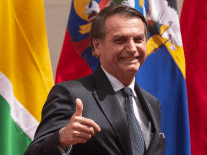 Brazil's President Jair Bolsonaro gives his thumb up during the signing of a declaration to kick off the Prosur regional initiative at La Moneda presidential palace in Santiago, on March 22, 2019. - The presidents of Chile, Colombia, Argentina, Brazil, Ecuador, Peru and Paraguay launched a new regional block that …