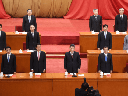 China's President Xi Jinping (C) and other leaders sing the national anthem at a ceremony marking the centennial of the May Fourth Movement, a landmark student protest against colonialism and imperialism, in Beijing's Great Hall of the People on April 30, 2019. - Xi Jinping exhorted China's youth on April …