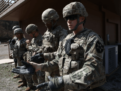 U.S. soldiers from 2nd Infantry Division take part in the Best Warrior Competition at the Rodriguez Range on April 16, 2019 in Pocheon, South Korea. The 2nd Infantry Division's annual Best Warrior Competition includes disciplines such as the Army Combat Fitness Test, the Eight-mile Foot March, land navigation as well …
