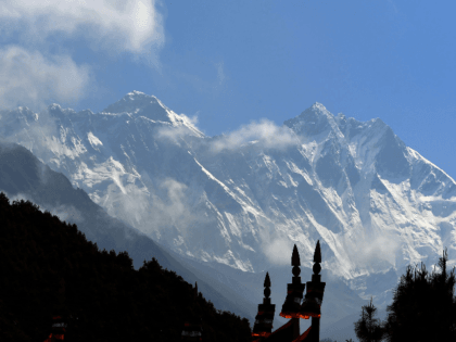 Mount Everest (height 8848 metres) is seen in the Everest region, some 140 km northeast of Kathmandu, on May 27, 2019. - Ten people have died in little more than two weeks after poor weather cut the climbing window, leaving mountaineers waiting in long queues to the summit, risking exhaustion …