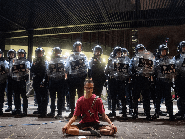 Police gather at a rally against a controversial extradition law proposal in Hong Kong on early June 10, 2019. - Hong Kong witnessed its largest street protest in at least 15 years on June 9 as crowds massed against plans to allow extraditions to China, a proposal that has sparked …