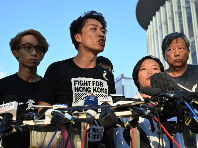 Civil Human Rights Front (CHRF) member Jimmy Sham (C) speaks during a press conference in Hong Kong on June 15, 2019 after Hong Kong Chief Executive Carrie Lam suspended a hugely divisive bill that would allow extraditions to China in a major climbdown after a week of unprecedented protests and …