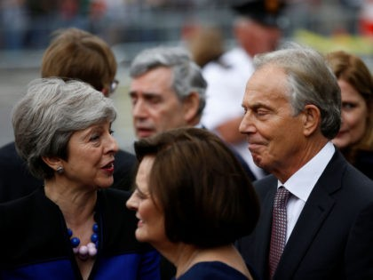 British Prime Minister Theresa May (L) speaks with former British Prime Minister Tony Blair after attending a service of thanksgiving for Lord Heywood in Westminster Abbey in London on June 20, 2019. (Photo by HENRY NICHOLLS / POOL / AFP) (Photo credit should read HENRY NICHOLLS/AFP/Getty Images)