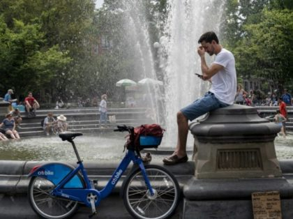 NEW YORK, NY - JULY 17: People cool off near the fountain at Washington Square Park during a hot afternoon day on July 17, 2019 in New York City. Sweltering heat is moving into the New York City area, with temperatures expected to rise close to 100 degrees by this …