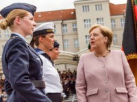 BERLIN, GERMANY - JULY 20: German Chancellor Angela Merkel (R) talks to soldiers during an oath-taking ceremony of the German army at the Defence Ministryon July 20, 2019 in Berlin, Germany. The pledge takes place in memory of the resistance against the National Socialist dictatorship on the occasion of the …
