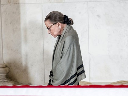 WASHINGTON, DC - JULY 22: Associate Justice Ruth Bader Ginsburg is the last justice to leave a private ceremony in the Great Hall of the Supreme Court where the late Supreme Court Justice John Paul Stevens lies in repose on July 22, 2019 in Washington, DC. Justice Stevens died at …