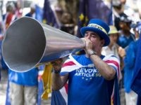 "Anti-Brexit campaigner Steve Bray protests outside the House of Commons on the day of Britain's newly elected prime minister Boris Johnson's debut in Parliament, in central London on July 25, 2019. - Britain's new Prime Minister Boris Johnson on Thursday called the current Brexit deal negotiated with the EU ""unacceptable"" …"