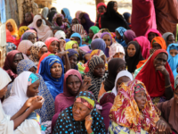 Women gather during a burial ceremony, after two people were killed by Boko Haram fighters in Dalori camp for internally displaced people, near Maiduguri, on July 26, 2019. - Two people were killed and several wounded when Boko Haram fighters raided a camp for people displaced by the jihadist conflict …