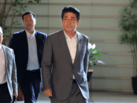 Japan's Prime Minister Shinzo Abe (R) arrives at the prime minister's office in Tokyo on July 31, 2019, after reports North Korea fired two ballistic missiles earlier in the morning. - Pyongyang fired two ballistic missiles on July 31, Seoul said, days after a similar launch that the nuclear-armed North …