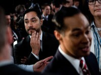 Joaquin Castro (L) listens to his brother Democratic presidential hopeful Former US Secretary of Housing and Urban Development Julian Castro (R) speak to reporters in the spin room after the second round of the second Democratic primary debate of the 2020 presidential campaign season hosted by CNN at the Fox …