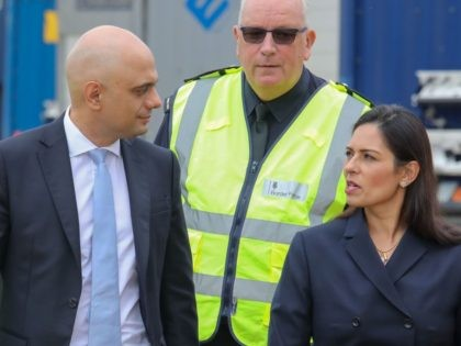 Britain's Chancellor of the Exchequer Sajid Javid (L) and Britain's Home Secretary Priti Patel (R) visit Tilbury Docks in Tilbury, east of London, on August 1, 2019. - Finance minister Sajid Javid announced Wednesday an extra £2.1 billion ($2.6 billion, 2.3 billion euros) to prepare for leaving without an agreement, …
