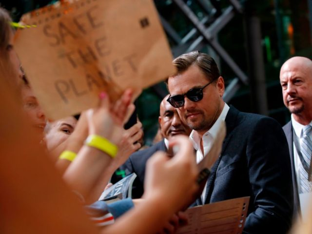 "US actor Leonardo DiCaprio signs autographs as he arrives for the German Premiere of US director Quentin Tarantino's latest film ""Once Upon A Time In Hollywood"" in Berlin on August 1, 2019. (Photo by Odd ANDERSEN / AFP) (Photo credit should read ODD ANDERSEN/AFP/Getty Images)"