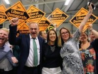 Liberal Democrat candidate Jane Dodds (C) celebrates with Liberal Democrat MP Ed Davey (L) and and her team after winning the Brecon and Radnorshire by-election at the Royal Welsh Showground on August 2, 2019 in Builth Wells, Wales. - Britain's Boris Johnson lost his first major test as prime minister …