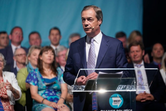 BIRMINGHAM, ENGLAND - JUNE 30: Brexit Party leader Nigel Farage addresses supporters from the stage at the party's Big Vision Rally at the National Exhibition Centre on June 30, 2019 in Birmingham, England. Organisers have said they are expecting 5000 attendees as the leadership unveiled the first 100 plus prospective …