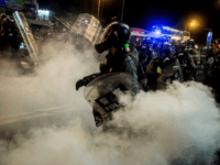 Police fire tear gas during a protest in the district of Causeway Bay in Hong Kong on August 4, 2019. - Riot police fired tear gas on August 4 at protesters on Hong Kong's main island, the second consecutive night of unrest in a territory battered by weeks of anti-government …