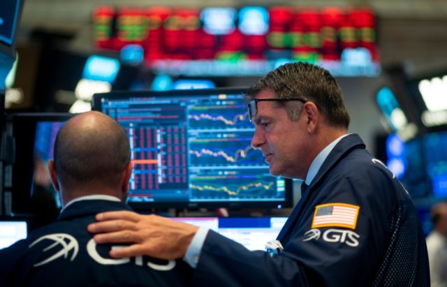 Traders react after the closing bell at the New York Stock Exchange (NYSE) on August 5, 2019 at Wall Street in New York City. - Wall Street stocks plunged after a forceful response by Beijing to the latest US tariff announcement escalated an ongoing trade war, exacerbating global growth worries. …