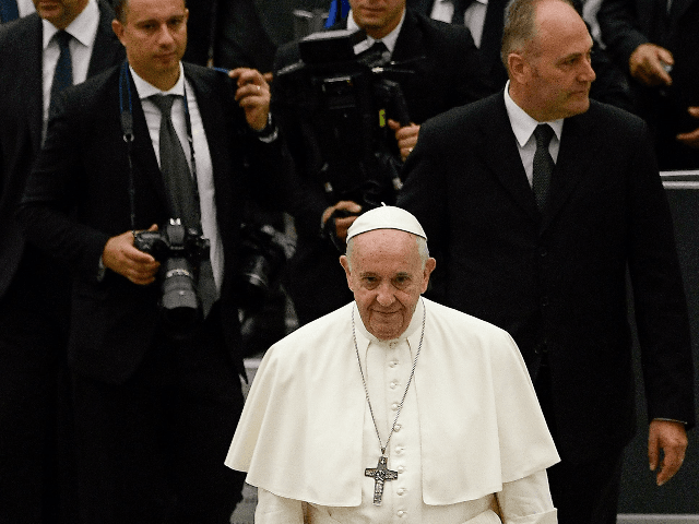 Pope Francis (C) leaves after his weekly general audience, in the Pope Paul VI hall at the Vatican on August 7, 2019. (Photo by Filippo MONTEFORTE / AFP) (Photo credit should read FILIPPO MONTEFORTE/AFP/Getty Images)