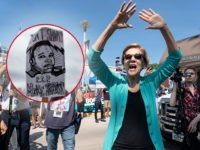 "(INSET: Sign reading ""RIP Mike Brown"" aka Michael Brown) 2020 Democratic presidential hopeful Senator Elizabeth Warren greets supporters as she arrives at a rally outside the building where the Wing Ding Dinner will take place on August 9, 2019 in Clear Lake, Iowa. - The dinner has become a must …"