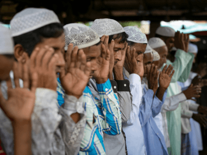 Rohingya Muslims celebrate Eid al-Adha in a refugee camp August 12, 2019 in Cox's Bazar, Bangladesh. Eid al-Adha, or the Festival of Sacrifice, marks the end of the Hajj pilgrimage to Mecca and in commemoration of Prophet Abraham's readiness to sacrifice his son to show obedience to God. Muslims slaughter …