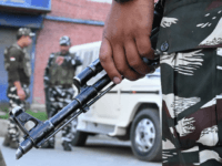 Security personnel stand guard on a street during a lockdown in Srinagar on August 12, 2019. - Indian troops clamped tight restrictions on mosques across Kashmir for Eid al-Adha festival, fearing anti-government protests over the stripping of the Muslim-majority region's autonomy, according to residents. (Photo by Tauseef MUSTAFA / AFP) …
