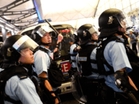 Police secure Terminal 1 after a scuffle with pre-democracy protestors at Hong Kong's International Airport on August 13, 2019. - Hundreds of flights were cancelled or suspended at Hong Kong's airport on August 13 as pro-democracy protesters staged a second disruptive sit-in at the sprawling complex, defying warnings from the …