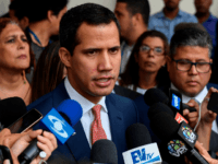 Venezuelan opposition leader and self-proclaimed acting president Juan Guaido speaks with journalists after taking part in a session at the National Assembly in Caracas on August 13, 2019. - Constituent Assembly ruled on Monday, to evaluate moving forward with elections of the National Assembly, the only power controlled by the …