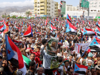 Yemeni Southern separatists supporters wave flags of the former South Yemen (The People's Democratic Republic of Yemen) as they demonstrate in the Khormaksar district of Yemen's second city of Aden on August 15, 2019. - Yemen's government on August 14 ruled out talks with southern separatists until they withdraw from …