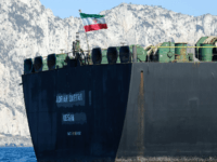 An Iranian flag flutters on board the Adrian Darya oil tanker, formerly known as Grace 1, off the coast of Gibraltar on August 18, 2019. - Gibraltar rejected a US demand to seize the Iranian oil tanker at the centre of a diplomatic dispute as it prepared to leave the …