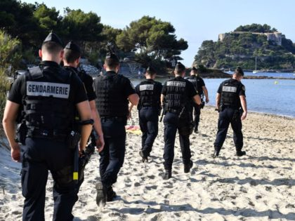 French Gendarmes patrol the beach in the vicinity of the French President' summer retreat, the medieval fort of Bregancon near the village of Bormes-les-Mimosas on France's Mediterranean coast on August 19, 2019, where he has invited his Russian counterpart for talks days before hosting a G7 summit. - World leaders …