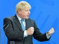 British Prime Minister Boris Johnson speaks to journalists with the German Chancellor at the Chancellery on August 21, 2019 in Berlin. - Johnson visits Berlin to kick off a marathon of tense talks with key European and international leaders as the threat of a chaotic no-deal Brexit looms. (Photo by …