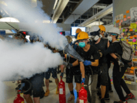 Protestors spray fire extinguishers during a protest at the Yuen Long MTR station on August 21, 2019 in Hong Kong, China. Pro-democracy protesters have continued rallies on the streets of Hong Kong against a controversial extradition bill since 9 June as the city plunged into crisis after waves of demonstrations …