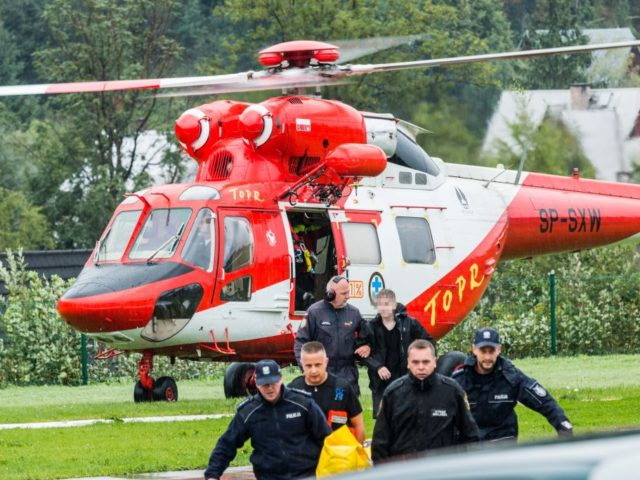 Polish rescue workers move injured tourists from a helicopter near Zakopane, Poland on August 22, 2019 after a sudden lightning storm killed five people, including two children, in the Polish and Slovakia Tatra mountains, and more than 20 others were injured. (Photo by Piotr KORCZAK / AFP) / Poland OUT …
