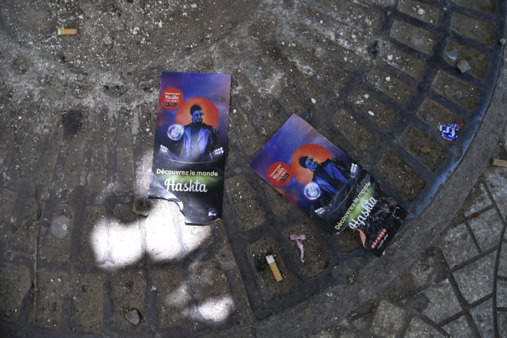 """A picture shows on August 23, 2019, flyers of rapper Soolking lying on the ground outside Algiers' August-20 Stadium where five young people were killed and dozens more injured in a stampede at a packed concert by the musician the previous night. - The stampede took place as fans thronged an entrance of the stadium where rapper Soolking was to perform. AFP there were five victims of the crush: """"two young girls aged 19 and 22 and three boys aged 13, 21 and 16."""" (Photo by RYAD KRAMDI / AFP) (Photo credit should read RYAD KRAMDI/AFP/Getty Images)"""