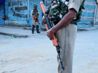 Security personnel stand guard in front of closed shops in Srinagar on August 23, 2019. - An Indian soldier was killed by Pakistani forces on the Kashmir border, the military said on August 23, as a tense lockdown in the region of seven million residents continued for the 19th day. …