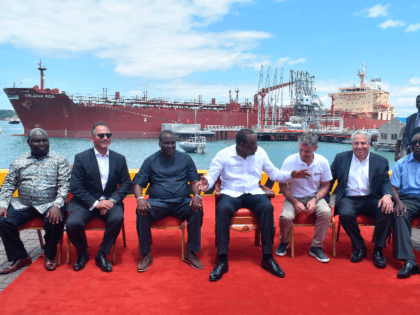 President Uhuru Kenyatta (C) poses in a group photo with other officials infront of an oil tanker carrying 200,000 barrels of crude oil worth Ksh 1.2 billion during the inaugural shipment of crude oil at Kipevu Oil Terminal at Kenya's port city of Mombasa August 26, 2019. - Kenya exported …