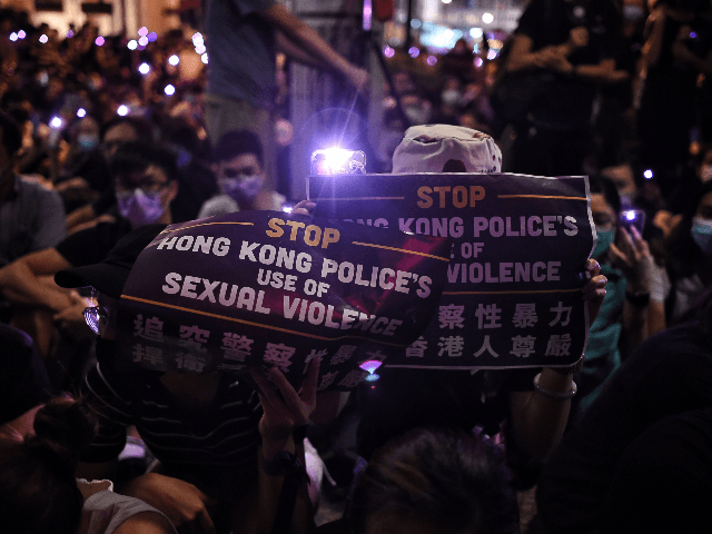 People take part in a #MeToo rally in Hong Kong on August 28, 2019, to protest alleged sexual assaults by police against anti-government female protesters. (Photo by Lillian SUWANRUMPHA / AFP) (Photo credit should read LILLIAN SUWANRUMPHA/AFP/Getty Images)