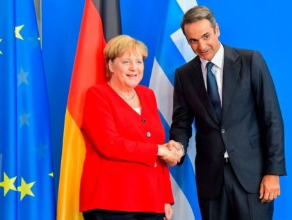 German Chancellor Angela Merkel(L)and Greek Prime Minister Kyriakos Mitsotakis(R)shake hands after addressing a joint press conference following talks at the Chancellery on August 29, 2019 in Berlin. (Photo by Tobias SCHWARZ / AFP) (Photo credit should read TOBIAS SCHWARZ/AFP/Getty Images)