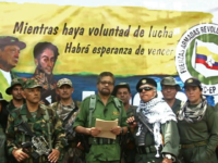 This TV grab taken from youtube and released on August 29, 2019 shows former senior commander Ivan Marquez(C) and fugitive rebel colleague, Jesus Santrich(wearing sunglass), of the dissolved FARC rebel army group in Colombia, on an undisclosed location of Colombia announcing that they are taking up arms again along with …