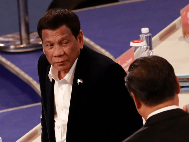 Philippine President Rodrigo Duterte (L) and Chinese President Xi Jinping attend the FIBA Basketball World Cup 2019 opening ceremony at the Beijing National Aquatics Center or Water Cube on 30 August 2019 in Beijing, China. (Photo by HOW HWEE YOUNG - Pool/Getty Images)