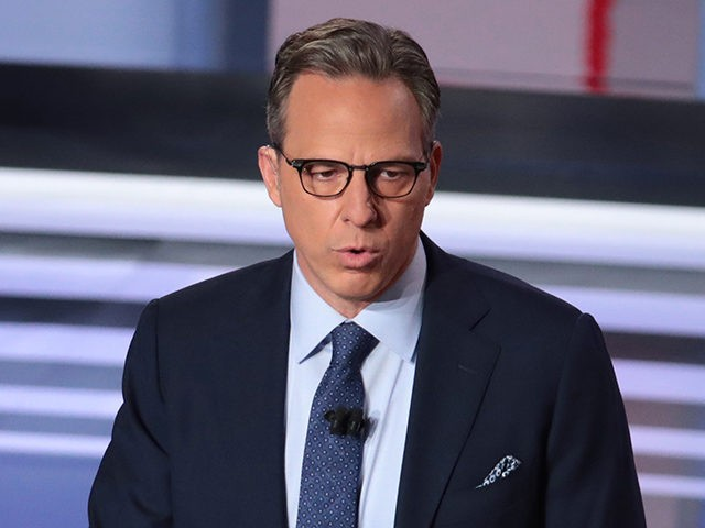 DETROIT, MICHIGAN - JULY 31: CNN moderator Jake Tapper speaks to the crowd attending the Democratic Presidential Debate at the Fox Theatre July 31, 2019 in Detroit, Michigan. 20 Democratic presidential candidates were split into two groups of 10 to take part in the debate sponsored by CNN held over …