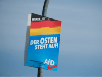 "JUTERBOG, GERMANY - AUGUST 09: An election campaign poster of the right-wing Alternative for Germany (AfD) reads: ""The East is standing up!"" ahead of state elections in Brandenburg state on August 09, 2019 in Juterbog, Germany. Brandenburg and Saxony, both states in eastern Germany, are due to hold elections on …"