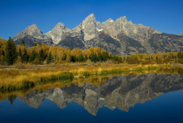 The Grand Tetons are seen October 4, 2012 in the Grand Teton National Park in Wyoming. Grand Teton National Park is located in northwestern Wyoming. Approximately 310,000 acres (130,000 ha) in size, the park includes the major peaks of the 40-mile (64 km) long Teton Range as well as most …