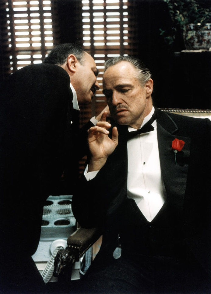 Marlon Brando receives a message in a scene from the film 'The Godfather', 1972. (Photo by Paramount/Getty Images)