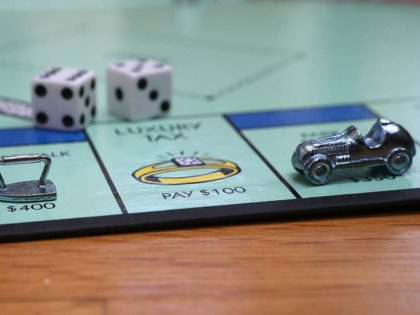 FAIRFAX, CA - FEBRUARY 06: In this photo illustration, The Monopoly iron and race car game pieces are displayed on February 6, 2013 in Fairfax, California. Toy maker Hasbro, Inc. announced today that fans of the board game Monopoly voted in an online contest to eliminate the iron playing figure …