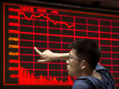 A Chinese day trader reacts as he watches a stock ticker at a local brokerage house on August 27, 2015 in Beijing, China. A dramatic sell-off in Chinese stocks caused turmoil in markets around the world, driving indexes lower and erasing trillions of dollars in value. China's government has implemented …