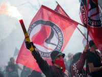 "People hold flags of anarchist party reading ""Antifacist"" as they demonstrate during a May Day rally on May 1, 2014 in Marseille, southern France. AFP PHOTO / BERTRAND LANGLOIS (Photo credit should read BERTRAND LANGLOIS/AFP/Getty Images)"
