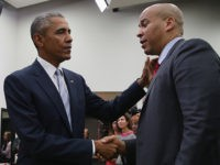 WASHINGTON, DC - SEPTEMBER 18: (AFP OUT) U.S. President Barack Obama (L) greets Sen. Corey Booker (D-NJ) during a gathering of actors, hip-hip artists, justice activists, state and local elected officials and community leaders advocating for criminal justice reform in the Eisenhower Executive Office Building South Court Auditorium September 18, …