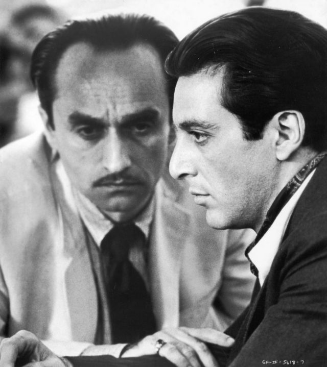 1974, American actor John Cazale (left) (1936 - 1978) puts his hand on the arm of American actor Al Pacino in a still from director Francis Ford Coppola's film, 'The Godfather; Part II,' based on the novel by Mario Puzo. (Photo by Paramount Pictures/Getty Images)