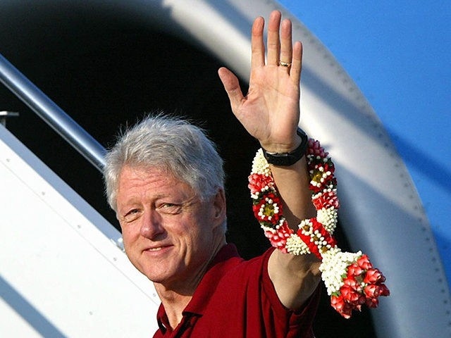 PHUKET, THAILAND: Former US president Bill Clinton waves as he walks up to the private plane to depart for Indonesia's tsunami-ravaged Aceh province following a visit to Phuket, southern Thailand, 20 February 2005. Former US presidents George Bush and Bill Clinton left Thailand early 20 February for Indonesia where they …